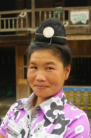 Ethnic Thai woman in front of her home Stock Photo