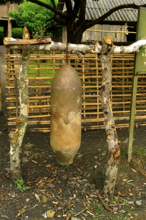 The bomb dropped by a B52 that did not explode now serves as wrong for the village assembly