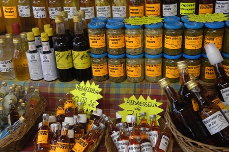 Martinique, rum bottles on a creole market Editorial