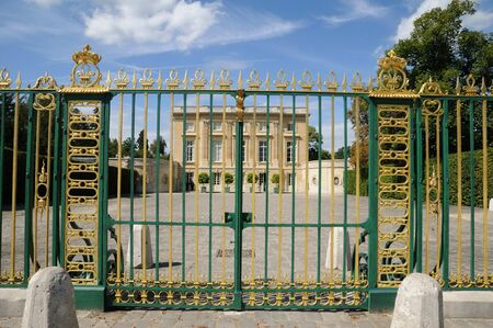 petit: gate of Petit Trianon in Versailles Editorial
