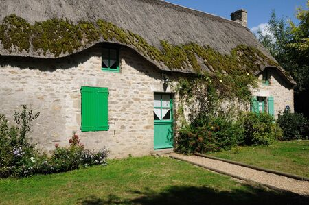 thatched cottage: France, old thatched cottage in Saint Lyphard