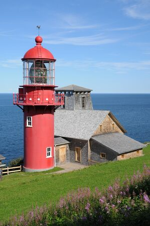 Canada, Quebec, the lighthouse of Pointe a la Renommee in Gaspesie photo