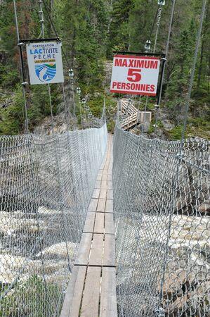 footbridge in Parc de la Caverne Trou de la Fee in Desbiens Stock Photo - 16961587