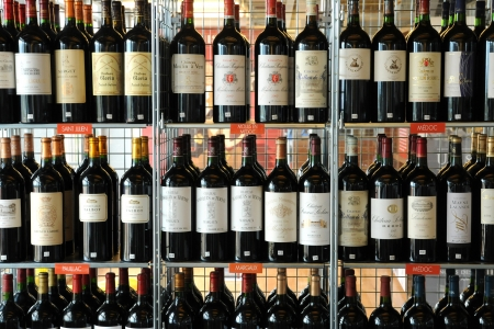 France, Aquitaine, bottles of Bordeaux in a shop