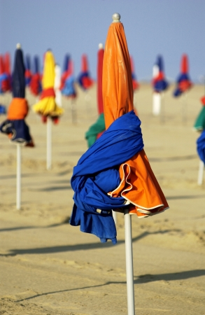 France, parasol on Deauville beach in Normandie