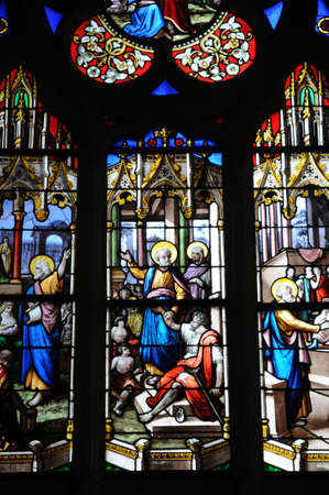 glasswork: France, stained glass window of Dives sur Mer church in Normandy Editorial