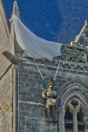 mere: France, paratrooper on the church of Sainte mere Eglise in Normandie