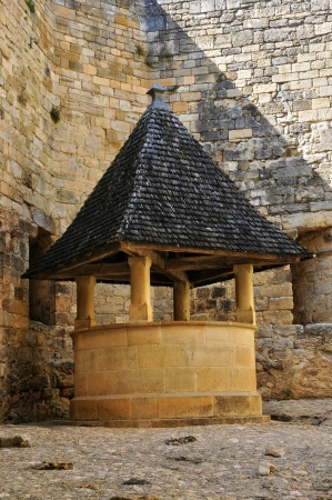 water well: France, the picturesque castle of Castelnaud water well in Dordogne Editorial