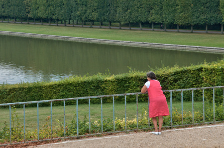 Ile de France, woman in the Versailles Palace park photo