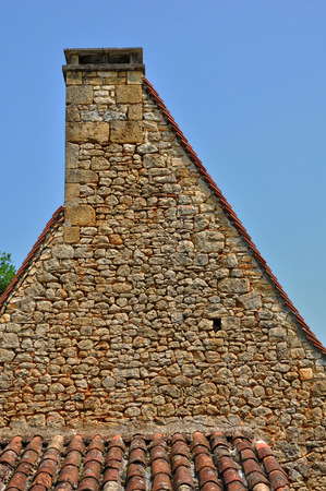 close up chimney: France, close up of a stone wall in Castelnaud la Chapelle Stock Photo
