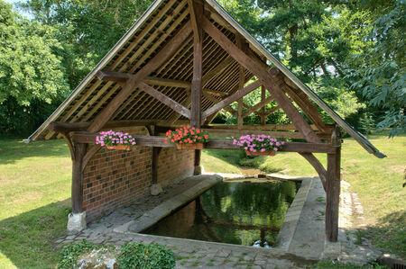 washhouse: Ile de France, the picturesque village of Montchauvet  Stock Photo