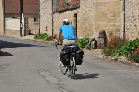 Ile de France, cyclotourist in the village of Themericourt in Val d Oise Stock Photo - 28281129
