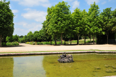 Pond at the Marie Antoinette estate in the parc of Versailles Palace photo