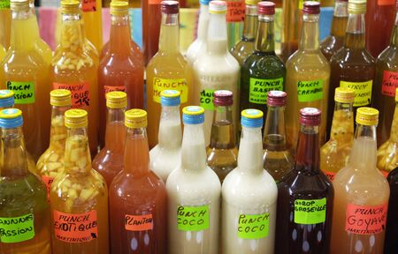 creole: Martinique, rum bottles on a creole market Editorial