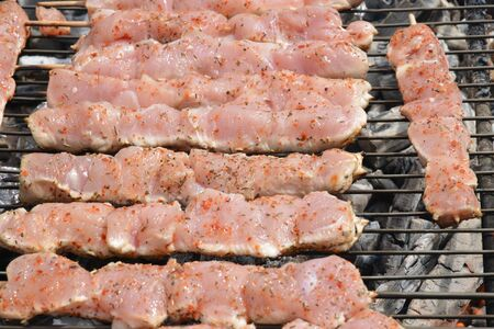 chiken: ile de france, close up of chiken meat on a barbecue