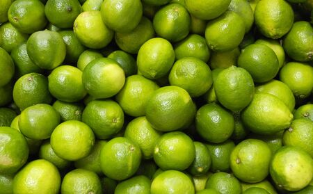 green lemons on the market