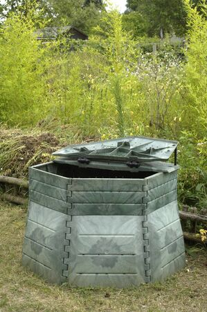 decomposed: compost barrel in a garden Stock Photo