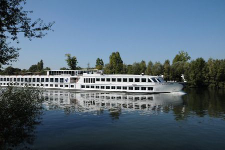 barge: Ile de France, a barge in Seine river in Les Mureaux Editorial