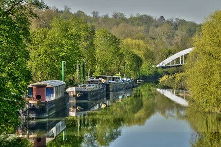 barge: Ile de France, barge in the picturesque city of Poissy Editorial