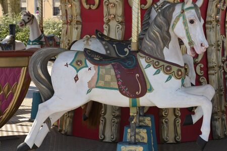 bourgogne: France, wooden horses on an old carousel in the city of Macon in Saone et Loire