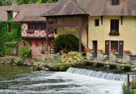 gastronomic: Fourges, France - august 13 2015 : the water mill wich is now a gastronomic restaurant Stock Photo
