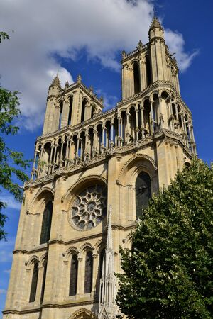 historically: Mantes la Jolie, France - august 12 2015 : The medieval Collegiate Church of Our Lady of Mantes is a large and historically important Catholic church constructed between c.1155 and 1350