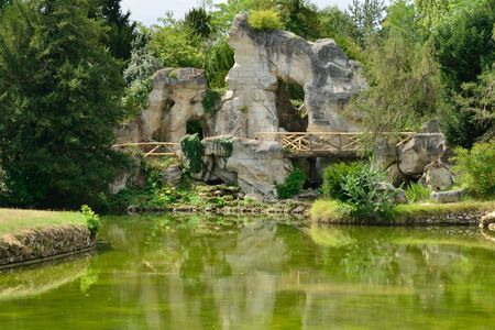 versailles: Versailles, France - august 19 2015 : the rock in the Marie Antoinette estate in the parc of Versailles Palace Editorial