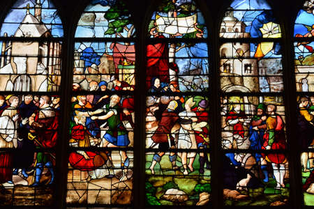 build in: Les Andelys, France - august 10 2015 : stained glass window of the collegiate church build in de 1225