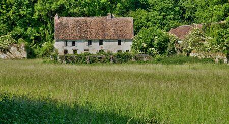 monument historical monument: Menouville, France - april 6 2015 : the farm of little castle in spring