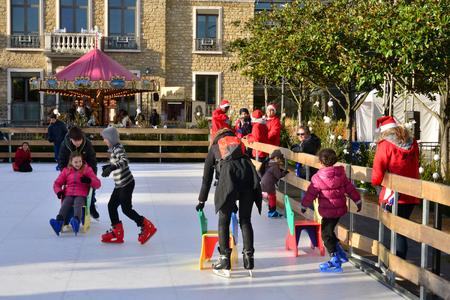 skating rink: Les Mureaux, France - december 23 2015 : the skating rink behind the city hall in winter Editorial