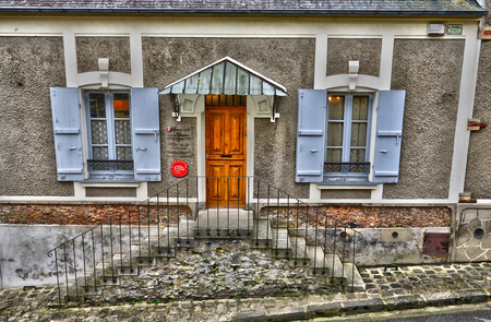 lived here: Montfort L Amaury, France - january 2 2016 : the house of Maurice Ravel. He lived here from 1921 to 1937