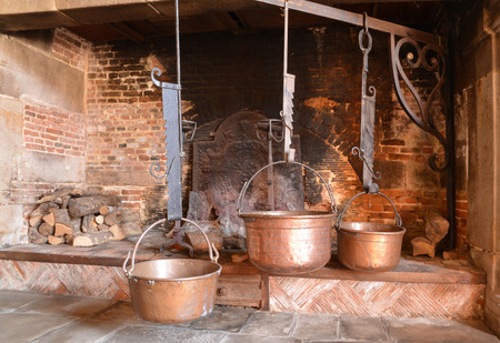 fire place: Varengeville sur Mer, France - july 16 2015 : the Ango manor built between 1530 and 1545 for Jean Ango, the Dieppe governor. cooking pot in a fire place Editorial