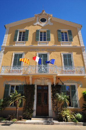 mimose: Bormes les Mimosas, France - april 18 2016 : the picturesque old city hall in spring
