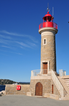 saint tropez: Saint Tropez;   the red lighthouse in the port