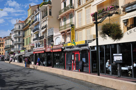 maritimes: Cannes, France - april 17 2016 : the picturesque old city center Editorial