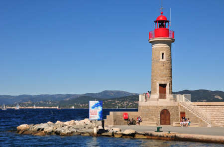 saint tropez: Saint Tropez; France - april 18 2016 : the red lighthouse in the port Editorial
