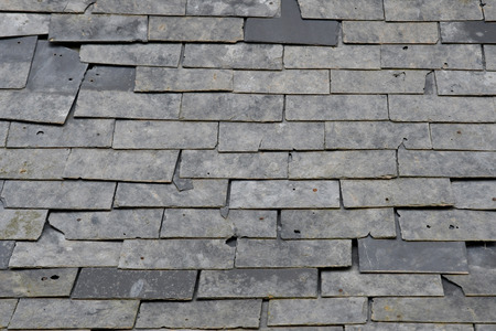 damaged roof: Esteville, France - june 23 2016 : damaged slate roof