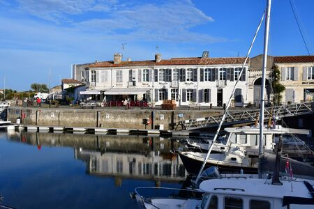 're: Saint Martin de Re, France - september 26 2016 : boats in the picturesque port Editorial