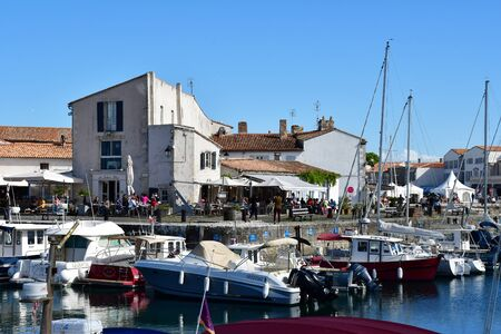 re: Saint Martin de Re, France - september 25 2016 : the picturesque village and boat in the port