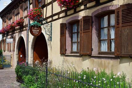 Eguisheim, France - july 23 2016 : wine grower in the historical village in summer Editorial