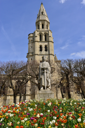 Poissy; France - may 2 2016 : statue of Saint Louis and the collegiate church