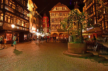 touristy: Strasbourg, France - july 24 2016 : the picturesque city center in summer night Editorial