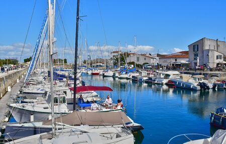 're: Saint Martin de Re, France - september 25 2016 : the picturesque village and boat in the port
