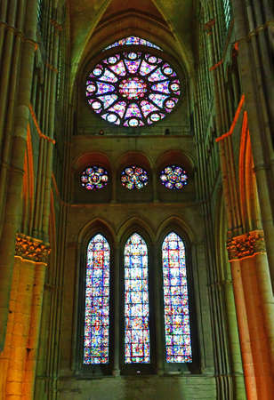 touristy: Reims, France - july 25 2016 : stained glass window of the Notre Dame cathedral where the kings of France were crowned