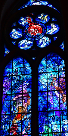 chagall: Reims, France - july 25 2016 : stained glass window of the Notre Dame cathedral drawn by Marc Chagall Editorial