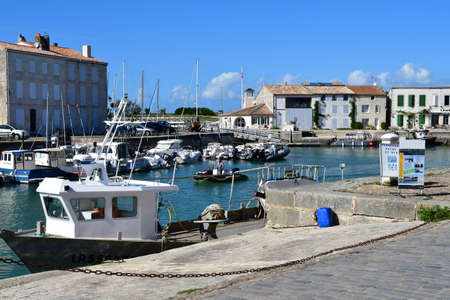 picturesque: Saint Martin de Re, France - september 25 2016 : the picturesque village and boat in the port