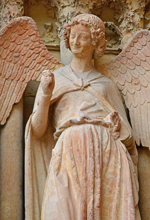 touristy: Reims, France - july 25 2016 : the smiling angel of the Notre Dame cathedral where the kings of France were crowned