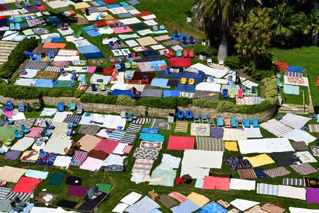 Santa Barbara, USA - july 15 2016 : beach towel exhibition near law court Editorial