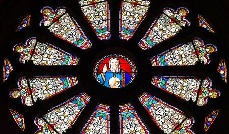 val: Auvers sur Oise , France - august 14 2016 : rose window in the Notre Dame de l Assomption church