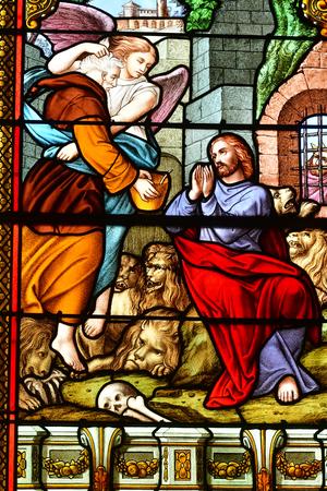 Les Mureaux, France - june 9 2018 : the Saint Pierre Saint Paul church stained glass window 에디토리얼